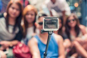 People Taking Picture With GoPro Selfie Stick Camera
